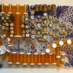 """By Mouth, Once Daily - 16.5"""" x 30.5"""" x 2.5"""", discarded Rx containers, corks, bottlecaps, straws on opaque plexiglas"""